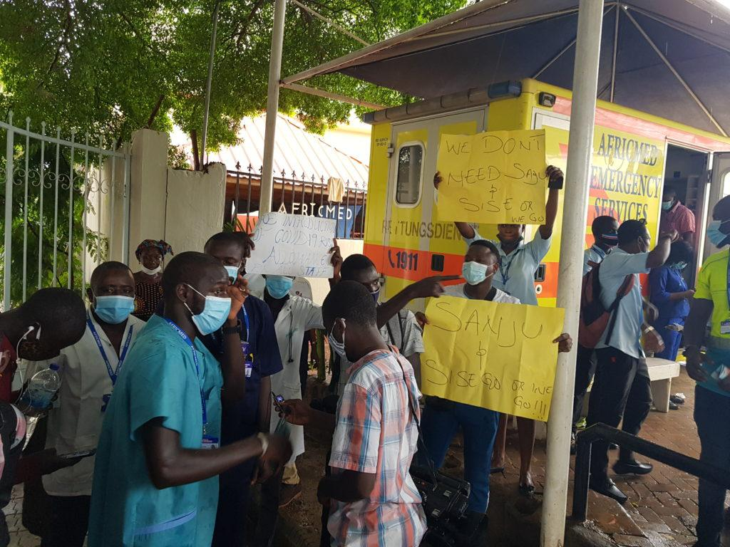 Africmed Staff holding banner