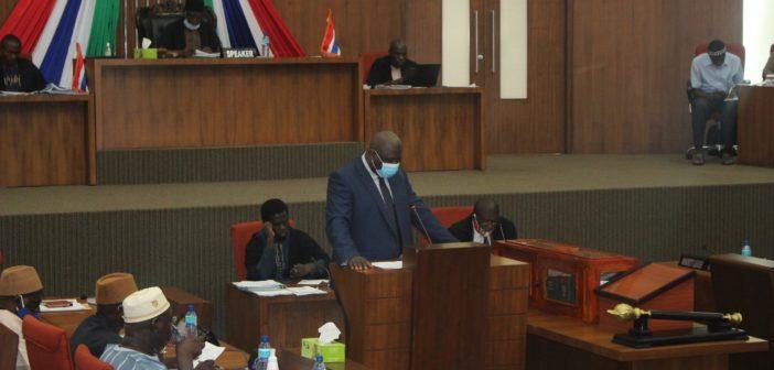 Attorney General, Dawda A Jallow tabling a Bill in Parliament
