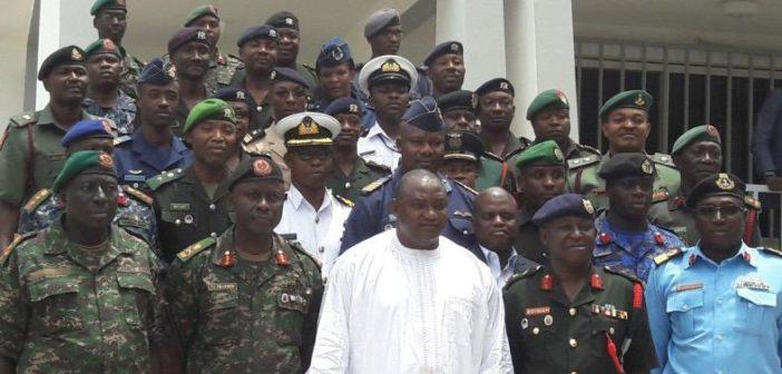 President Barrow (C) and Security Officers