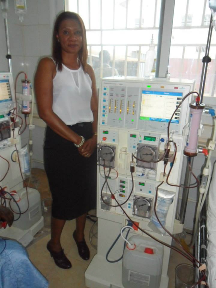 2014 Trip to Gambia, Founder Sailey next to Donated Dialysis Equipment