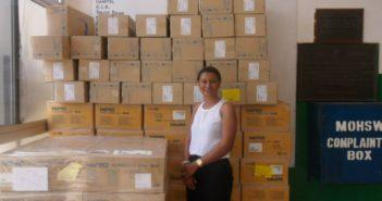 2014 Trip to Gambia, Founder Sailey next to donations